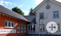 Außenansicht Kinderhaus St. Raphael mit bemalter Fassade.